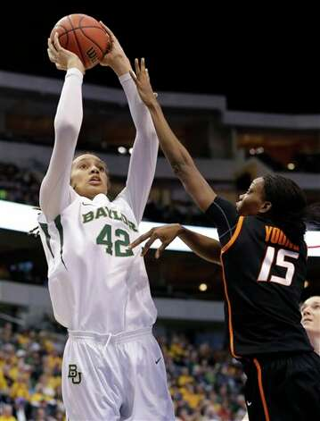 Baylor center Brittney Griner (42) attempts a shot over Oklahoma State' Toni Young (15) in the first half of an NCAA college basketball game in the Big 12 women's tournament on Sunday, March 10, 2013, in Dallas. (AP Photo/Tony Gutierrez) Photo: Tony Gutierrez, Associated Press / AP