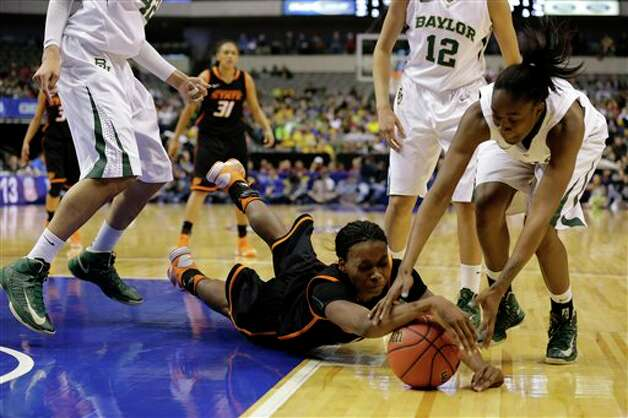 Oklahoma State forward Toni Young, center, dives to grab a loose ball against Baylor' Jordan Madden, right, as Baylor's Brittney Griner, top, left, Alexis Prince (12) and Oklahoma State's Kendra Suttles (31) watch in the second half of an NCAA college basketball game in the Big 12 women's tournament Sunday, March 10, 2013, in Dallas. Baylor won 77-69. (AP Photo/Tony Gutierrez) Photo: Tony Gutierrez, Associated Press / AP
