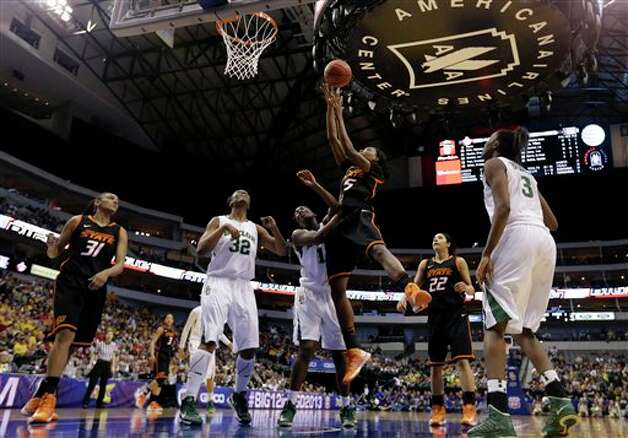 Oklahoma State's Toni Young (15) goes up for a score over Baylor guard Kimetria Hayden (1) as Brooklyn Pope (32), Jordan Madden (3) and Oklahoma State's Kendra Suttles (31) and Brittney Martin (22) watch in the second half of an NCAA college basketball game in the Big 12 women's tournament Sunday, March 10, 2013, in Dallas. Baylor won 77-69. (AP Photo/Tony Gutierrez) Photo: Tony Gutierrez, Associated Press / AP