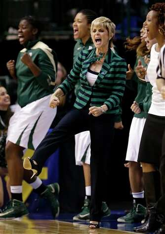 Baylor head coach Kim Mulkey and the bench celebrate a score by Baylor's Brooklyn Pope (32) in the second half of an NCAA college basketball game against Oklahoma State in the Big 12 women's tournament Sunday, March 10, 2013, in Dallas. Baylor won 77-69. (AP Photo/Tony Gutierrez) Photo: Tony Gutierrez, Associated Press / AP