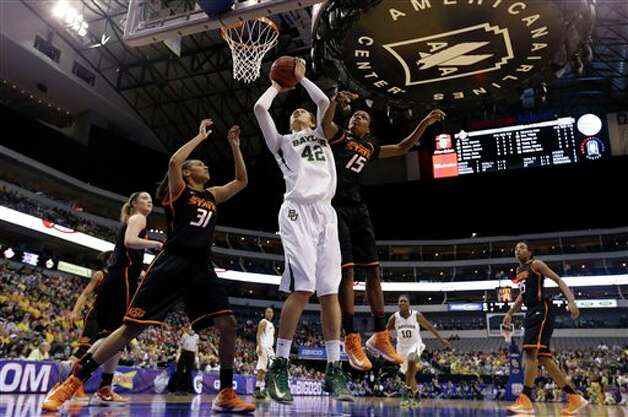 Baylor' Brittney Griner (42) goes up for a score against Oklahoma State' Kendra Suttles (31) and Toni Young (15) in the first half of an NCAA college basketball game in the Big 12 women's tournament on Sunday, March 10, 2013, in Dallas. (AP Photo/Tony Gutierrez) Photo: Tony Gutierrez, Associated Press / AP