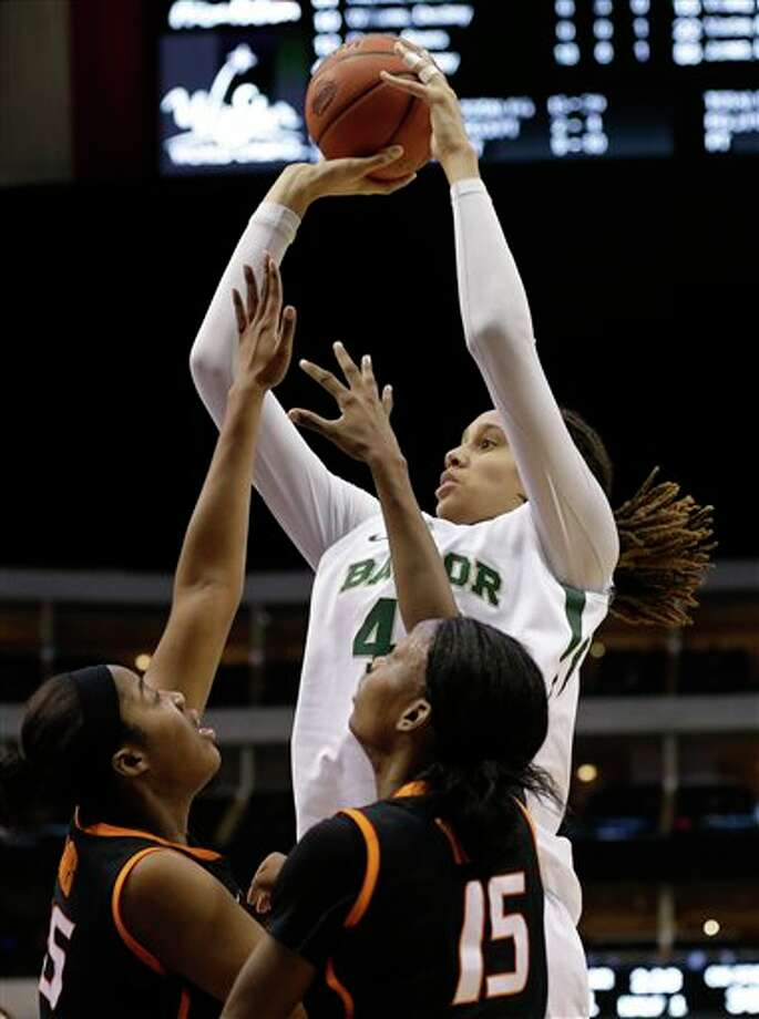 Oklahoma State' LaShawn Jones (55) and Toni Young (15) defend as Baylor's Brittney Griner (42) goes up for a score in the first half of an NCAA college basketball game in the Big 12 women's tournament on Sunday, March 10, 2013, in Dallas. (AP Photo/Tony Gutierrez) Photo: Tony Gutierrez, Associated Press / AP