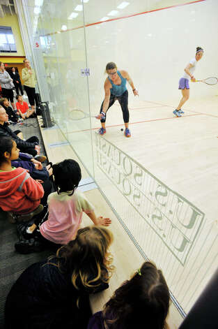 Spectators watch the U.S. Womens Squash Championships at Chelsea Piers in Stamford on Sunday, March 10, 2013. Photo: Jason Rearick / The Advocate