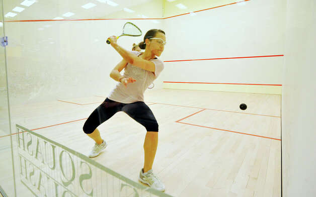 Cecilia Cortes, grey top, of Cambridge, Mass., competes against Niki Clement, in blue, of Bryn Mawr, Pa., during the Womens U.S. Squash Consolation game at Chelsea Piers in Stamford on Sunday, March 10, 2013. Photo: Jason Rearick / The Advocate