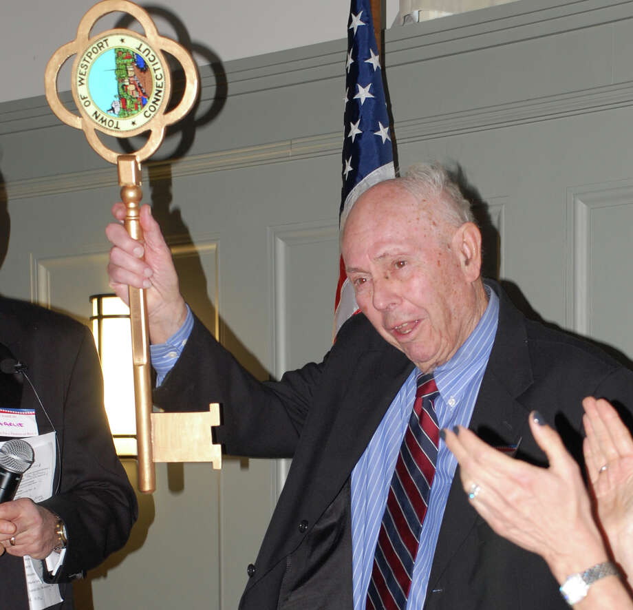 Bill Meyer, a longtime civic volunteer and Representative Town Meeting member, holds aloft the key to the town during a testimonial in his honor attended by several hundred people.  WESTPORT NEWS, CT 3/10/13 Photo: Jarret Liotta / Westport News contributed