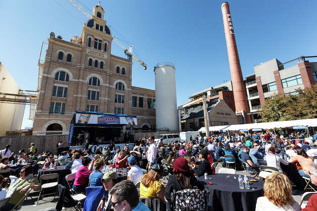 The crowd enjoys paella and music on the grounds of the Pearl Brewery during the 4th Annual Corona Paella Challenge, hosted by La Gloria chef, Johnny Hernandez, on Sunday, March 10, 2013.  Twenty-five of the top chefs in this country and throughout Latin America competed in the event as well as five area high schools. Photo: Marvin Pfeiffer / San Antonio Express-News / Express-News 2013