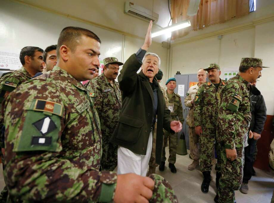 Chuck Hagel, center, is making his first visit to Afghanistan since becoming U.S. defense secretary. Photo: Pool / 2013 Getty Images