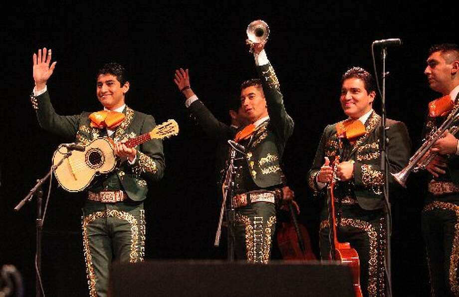 One of the finalist bands celebrates advancing at Mariachi Invitational 2013.