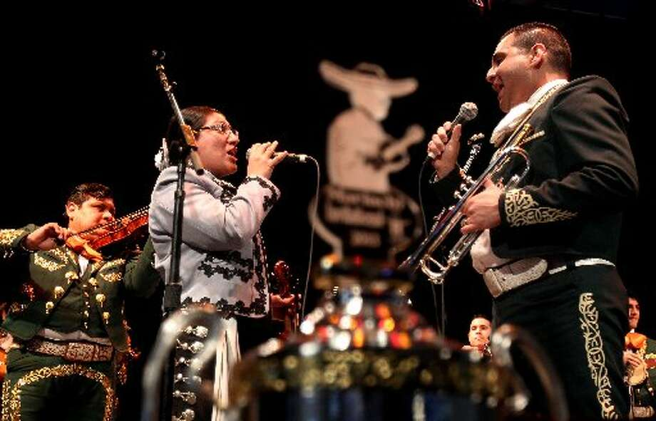 Yesenia Garcia and Oscar Garza, Jr. sing a closing number during the Mariachi Invitational 2013.