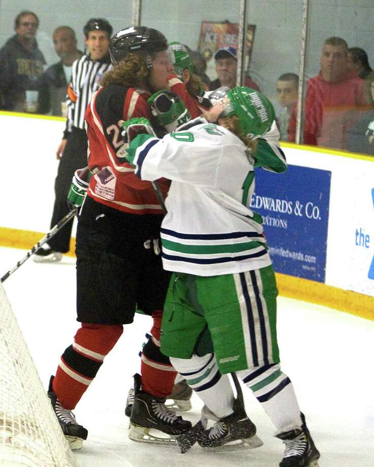 The Whalers' Chris Atkinson, right, and the Privateers' Jamie Zaleski meet during an FHL playoff semifinal game Sunday night, Mar. 10, 2013, at the Danbury Arena. Photo: Barry Horn