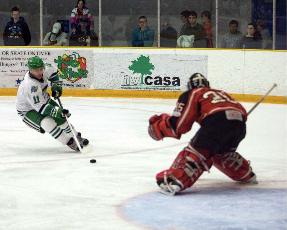 The Whalers' Phil Aucoin skates in one Thousand Islands goalie Matt Anthony during an FHL semifinal playoff game Sunday night, Mar. 10, 2013, at the Danbury Arena. Photo: Barry Horn / The News-Times Freelance
