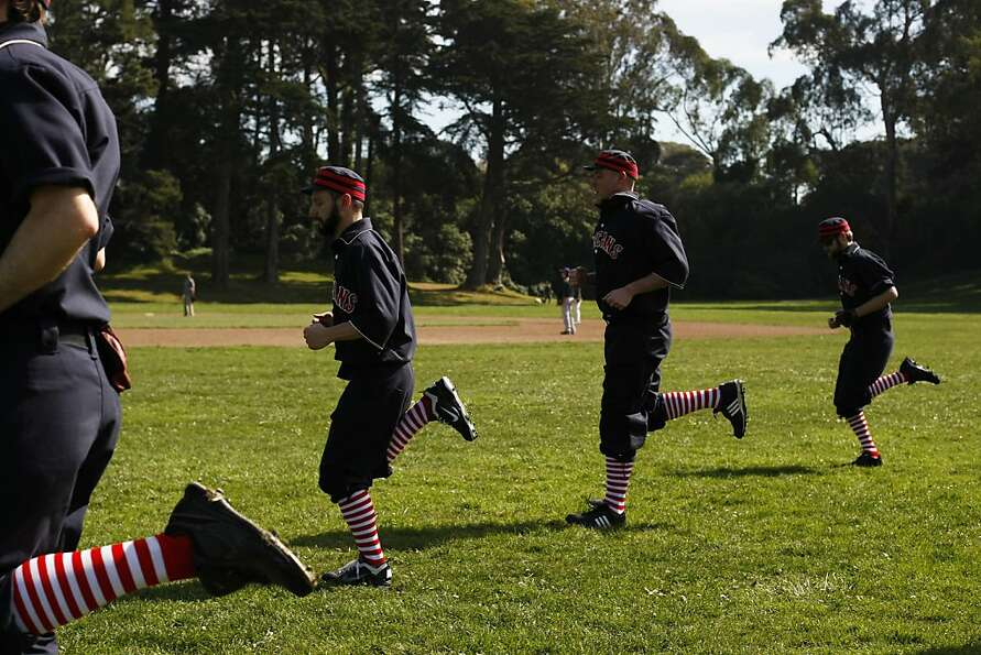 The San Francisco Pelicans warm up in Golden Gate Park before a round of vintage baseball on Sunday,
