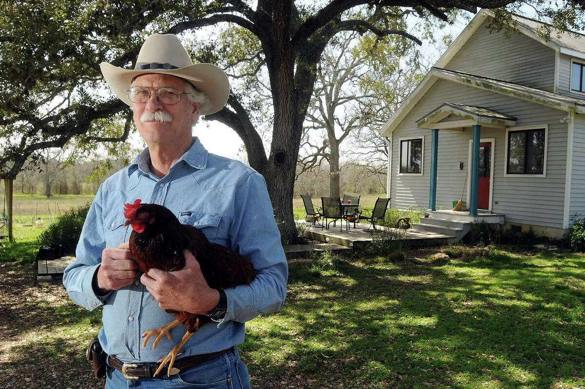 """In this Feb. 25, 2013 photo, Jim Kearney poses at his ranch near Weimar,Texas. Jim Kearney is also an amalgam, a scholar/rancher who still lives on and works the family ranch in Weimar. """"I put on different hats,"""" is how he puts it. Tall and lean, with a serious mustache, he looks like the rancher from Central Casting. But Kearney, who has his doctorate and will be teaching a course in European immigration into Texas at UT this fall, has encyclopedic knowledge of the German history of Texas."""