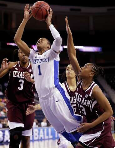 Kentucky guard A'dia Mathies (1) drives between Texas A&M's Courtney Walker (33) and Kelsey Bone (3) during the first half of their  NCAA college basketball game in the finals of the Southeastern Conference tournament, Sunday, March 10, 2013, in Duluth, Ga.  (AP Photo/John Bazemore) Photo: John Bazemore, Associated Press / AP