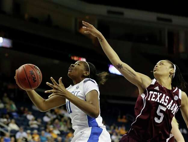 Kentucky center DeNesha Stallworth (11) goes to the basket against Texas A&M forward Kristi Bellock (5) during the first half of an NCAA college basketball game in the championship of the Southeastern Conference tournament, Sunday, March 10, 2013, in Duluth, Ga. (AP Photo/John Bazemore) Photo: John Bazemore, Associated Press / AP
