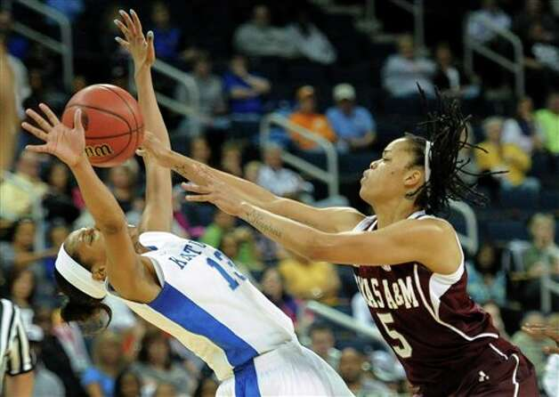 Texas A&M forward Kristi Bellock (5) passes through the arms of Kentucky guard Bria Goss (13) as she runs into her during the first half of an NCAA college basketball game in the championship of the Southeastern Conference tournament, Sunday, March 10, 2013, in Duluth, Ga. (AP Photo/John Amis) Photo: John Amis, Associated Press / FR69715 AP