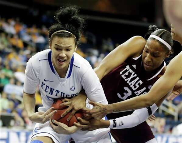 Kentucky forward/center Azia Bishop (50) and Texas A&M center Kelsey Bone (3) fight for the ball during the first half of an NCAA college basketball game in the championship of the Southeastern Conference tournament, Sunday, March 10, 2013, in Duluth, Ga. (AP Photo/John Bazemore) Photo: John Bazemore, Associated Press / AP