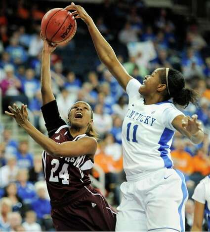 Kentucky center DeNesha Stallworth (11) gets her hand on the shot of Texas A&M guard Jordan Jones (24) during the first half of an NCAA college basketball game in the championship of the Southeastern Conference tournament, Sunday, March 10, 2013, in Duluth, Ga. (AP Photo/John Amis) Photo: John Amis, Associated Press / FR69715 AP
