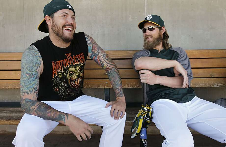 Pitcher Travis Blackley and outfielder Josh Reddick are friends and roommates in spite of their differences. Photo: Michael Macor, The Chronicle
