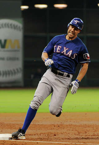 Texas Rangers' David Murphy rounds third base on a three-run, inside-the-park homer against the Houston Astros in the third inning of a baseball game Saturday, May 19, 2012, in Houston. (AP Photo/Pat Sullivan) Photo: Pat Sullivan, Associated Press / AP