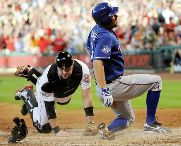 Texas Rangers' David Murphy (7) scores on a three-run, inside-the-park home run as Houston Astros catcher Chris Snyder dives in in the third inning of a baseball game Saturday, May 19, 2012, in Houston. (AP Photo/Pat Sullivan) Photo: Pat Sullivan, Associated Press / AP
