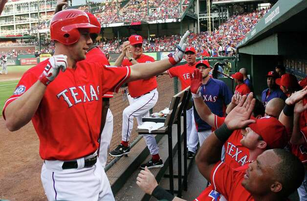 Texas Rangers' David Murphy (7) celebrates his two-run home run in the second inning against the Detroit Tigers during a baseball game in Arlington, Texas, Wednesday, June 27, 2012. (AP Photo/Richard Rodriguez) Photo: Richard W. Rodriguez, Associated Press / FR170526 AP