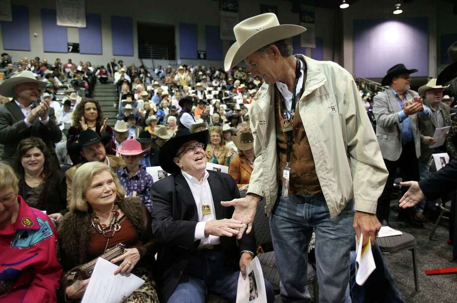 "(left to right) Ken Hucherson shakes hands with Joe Van Matre after winning The Grand Champion Best of Show ""Stowing the Riggings"" by Dennise Molina, of Pasadena ISD, during the School Art Auction at Reliant Arena Sales Pavilion on Thursday, Dec. 4, 2008, in Houston. Photo: Mayra Beltran, Houston Chronicle / TXHOU"