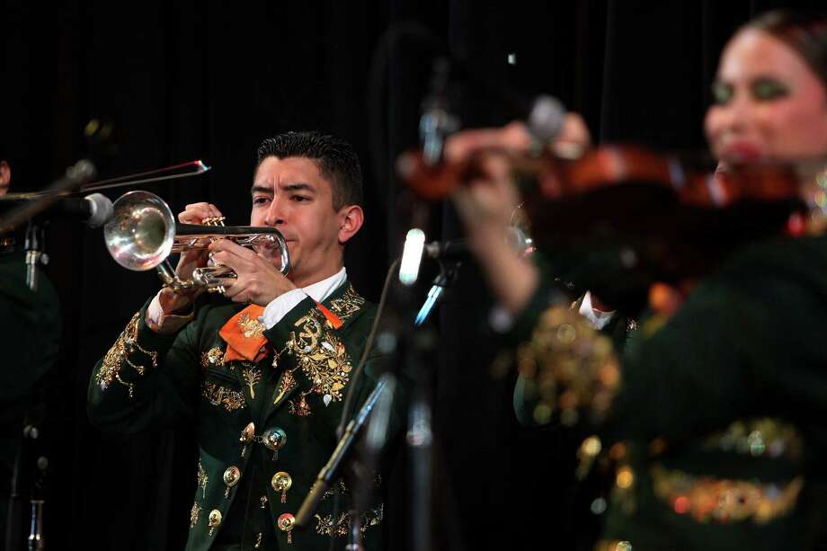 David Moreno and the University of Texas Pan American performs and wins the Mariachi Invitational 2013 during the Houston Livestock Show and Rodeo at Reliant Stadium on Sunday, March 10, 2013, in Houston. Photo: Mayra Beltran, Houston Chronicle / © 2013 Houston Chronicle
