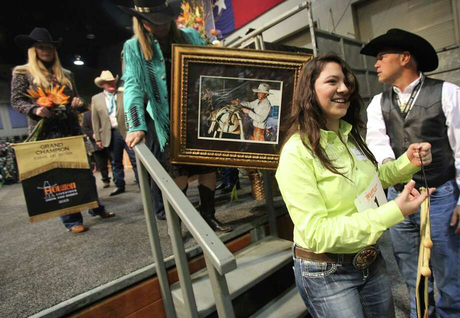 "The Grand Champion Best of Show Denisse Molina, of Pasadena ISD, smiles after her piece ""Stowing the Riggings"" was auctioned off during the School Art Auction at Reliant Arena Sales Pavilion on Thursday, Dec. 4, 2008, in Houston. Photo: Mayra Beltran, Houston Chronicle / TXHOU"