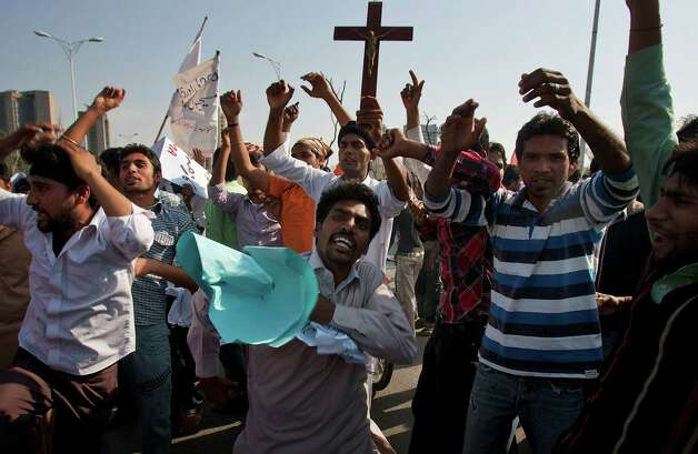 Pakistani Christians chant slogans during a demonstration demanding that the government rebuild their homes after they were burned down following an alleged blasphemy incident, in Islamabad, Pakistan, Sunday, March 10, 2013. The incident in Lahore began on Friday, March 8, 2013 after a Muslim accused a Christian man of blasphemy, an offence that in Pakistan is punished by life in prison or death. (AP Photo/Anjum Naveed) Photo: Anjum Naveed