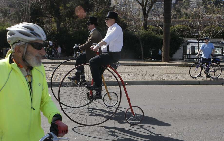 Kevin Storm and Croy Pelliter ride along Embarcadero on their penny farthings on March 10th, 2013 along Embarcadero in San Francisco, Calif.  The first Sunday Streets event to be held along the northbound Embarcadero from King Street to Fishermanâs Wharf and down 3rd Street to Mission Bay. The 3.3-mile route is available to pedestrians and bicyclists for recreational activities. Photo: Jessica Olthof, The Chronicle