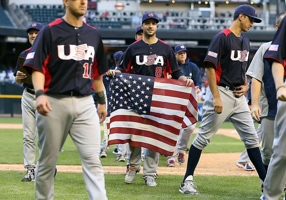 PHOENIX, AZ - MARCH 10:  Ryan Braun #9 of USA carries a flag in celebration after defeating Canada 9-4 in the World Baseball Classic First Round Group D game at Chase Field on March 10, 2013 in Phoenix, Arizona.  (Photo by Christian Petersen/Getty Images) Photo: Christian Petersen, Getty Images