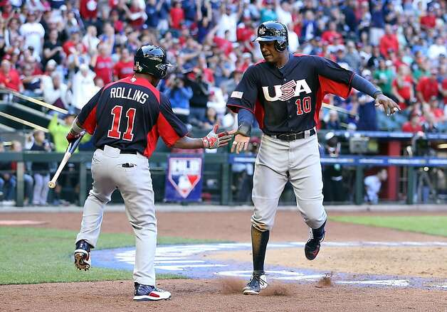 PHOENIX, AZ - MARCH 10:  Adam Jones #10 of USA celebrates with Jimmy Rollins #11 after scoring a run against Canada during the eighth inning of the World Baseball Classic First Round Group D game at Chase Field on March 10, 2013 in Phoenix, Arizona. USA defeated Canada 9-4. (Photo by Christian Petersen/Getty Images) Photo: Christian Petersen, Getty Images