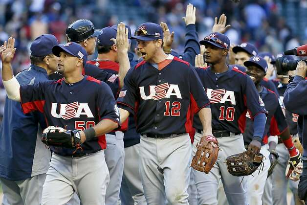 United States' Shane Victorino, left, Ben Zobrist (12) and Adam Jones (10) celebrate a win over Canada after the ninth inning in a World Baseball Classic baseball game on Sunday, March 10, 2013, in Phoenix.  The United States defeated Canada 9-4. (AP Photo/Ross D. Franklin) Photo: Ross D. Franklin, Associated Press