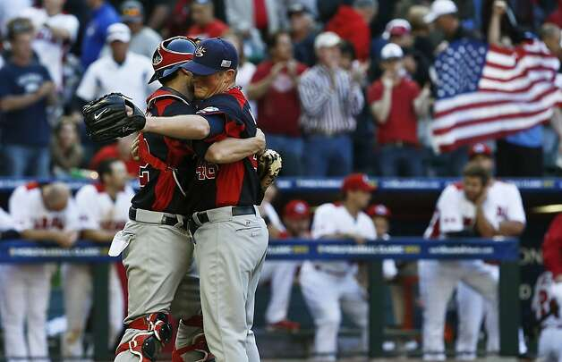 United States' Craig Kimbrel, right, and Jonathan Lucroy celebrate the final out in a win over Canada in the ninth inning during a World Baseball Classic baseball game on Sunday, March 10, 2013, in Phoenix.  The United States defeated Canada 9-4. (AP Photo/Ross D. Franklin) Photo: Ross D. Franklin, Associated Press