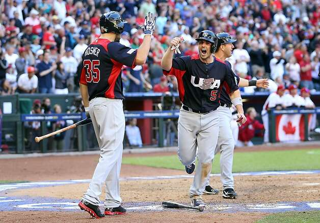 PHOENIX, AZ - MARCH 10:  David Wright #5 of USA celebrates with Eric Hosmer #35 after scoring against Canada during the eighth inning of the World Baseball Classic First Round Group D game at Chase Field on March 10, 2013 in Phoenix, Arizona.  USA defeated Canada 9-4. (Photo by Christian Petersen/Getty Images) Photo: Christian Petersen, Getty Images