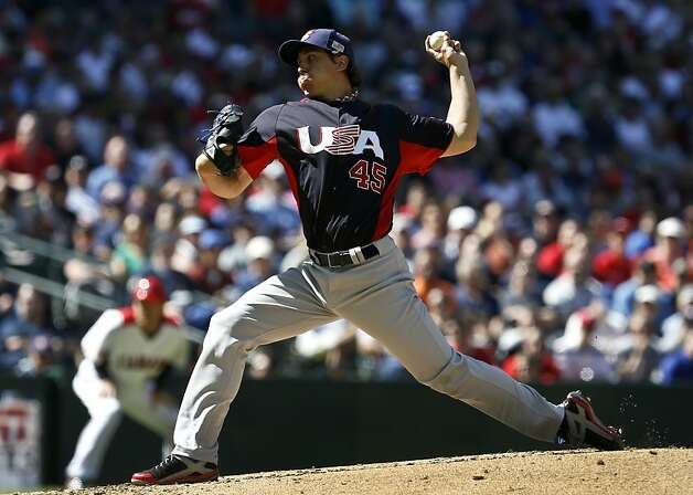 United States' Derek Holland (45) throws a pitch against Canada in the second inning during a World Baseball Classic baseball game on Sunday, March 10, 2013, in Phoenix. (AP Photo/Ross D. Franklin) Photo: Ross D. Franklin, Associated Press