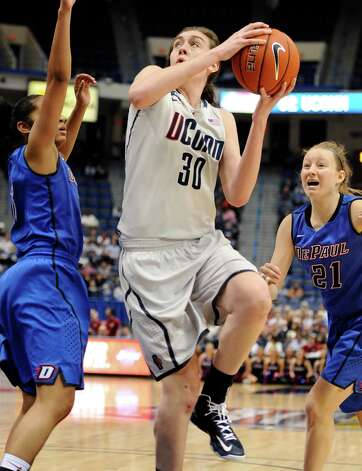 Connecticut's Breanna Stewart, center, splits the defense of DePaul's Chanise Jenkins, left, and DePaul's Megan Rogowski, right, in the second half of an NCAA college basketball game in the quarterfinals of the Big East Conference women's tournament in Hartford, Conn in Hartford, Conn., Sunday, March 10, 2013. Connecticut won 94-61. (AP Photo/Jessica Hill) Photo: Jessica Hill, Associated Press / FR125654 AP