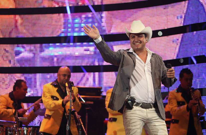Julion Alvarez performs during the Houston Livestock Show and Rodeo at Reliant Stadium on Sunday, Ma
