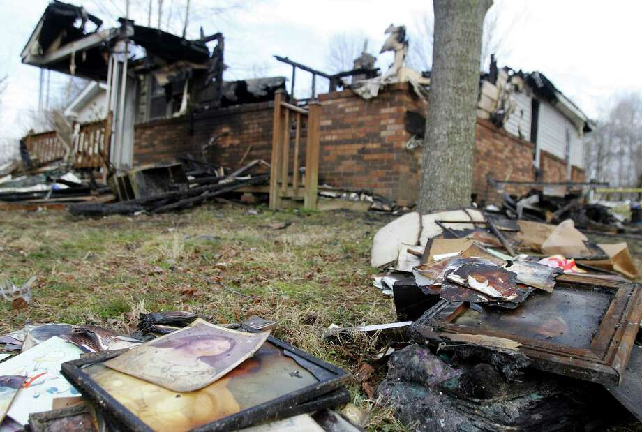 Charred debris is scattered outside of a rural Kentucky house in which a couple and five young children died from the Saturday morning blaze. Photo: Lisa Norman-Hudson / Associated Press