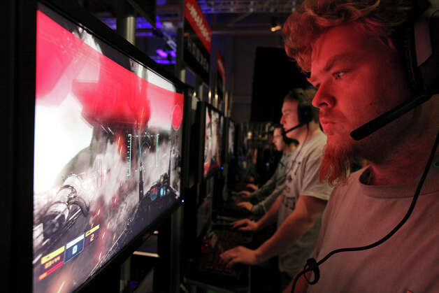 "Howard Edwards (right) and others play the video game ""Hawken"" at the Palmer Events Center during the South by Southwest Gaming Expo Sunday March 10, 2013 in Austin, TX. Photo: Edward A. Ornelas, San Antonio Express-News / © 2013 San Antonio Express-News"