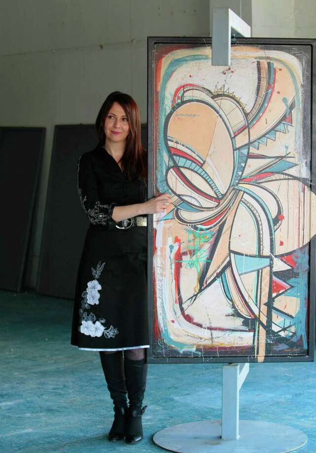 Karine Parker-Lemoyne, executive director of the Texan French Alliance for the Arts, says the swinging, painted steel doors - this one by French artist Romain Froquet - will be placed on display at 13 locations around Houston. Photo: Billy Smith II, Staff