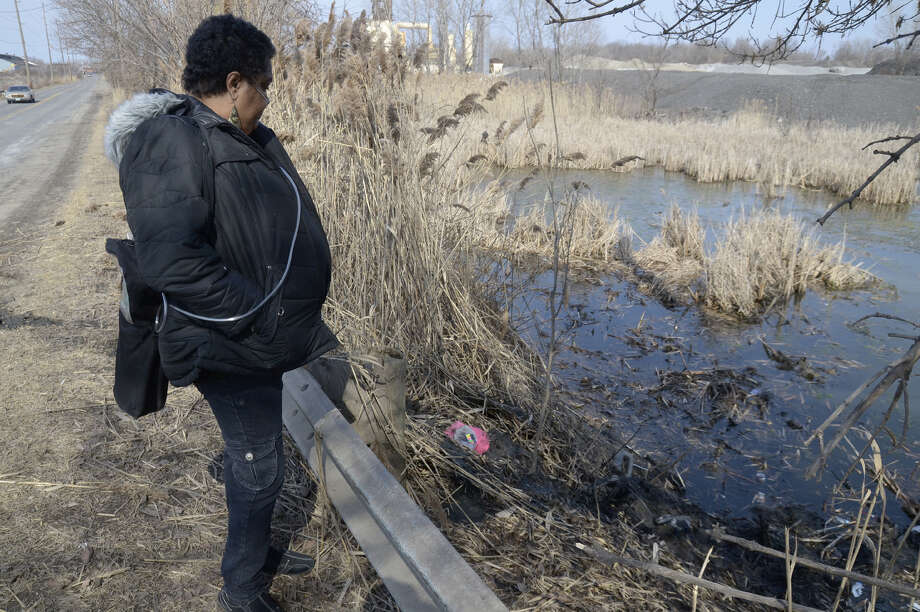 Carol Trimble of Warren, a family member of the victims, views the pond along Pine Avenue S.E. in Warren, Ohio where police say six teens were killed in the crash, Sunday, March 10, 2013. (AP Photo/Tribune Chronicle, R. Michael Semple) Photo: R. Michael Semple