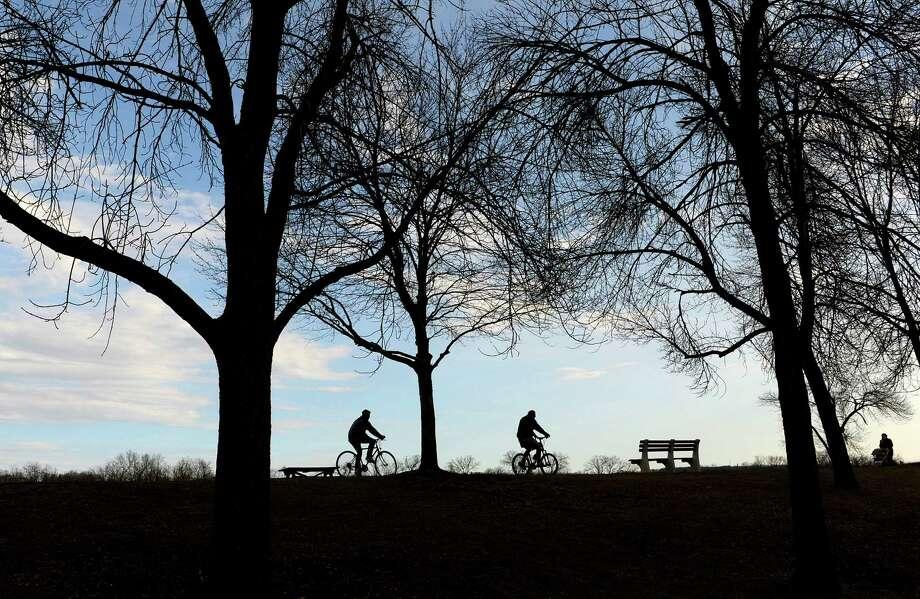 Bicyclists ride along the bike path on a warm Sunday afternoon, March 10, 2013 in Albany, NY.   (Paul Buckowski / Times Union) Photo: Paul Buckowski