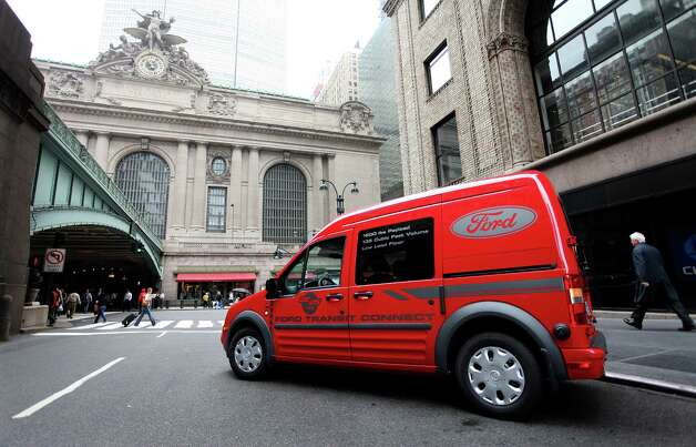 A Ford Transit Connect van, one of the carmakers' natural gas offerings, sits near Grand Central Terminal in New York. Ford tripled its sales of natural gas vehicles from 2010 to 2012. Photo: Associated Press File Photo