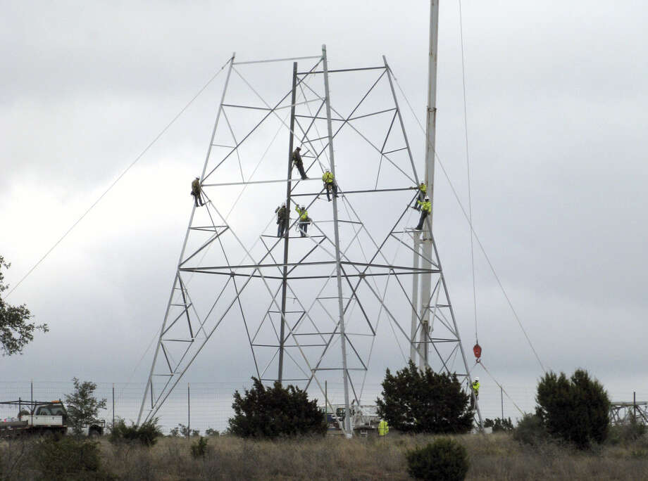 Crews erecting lattice-style towers have been a common sight in unincorporated areas along Interstate 10 between Comfort and Kerrville in recent weeks. The lines, which drew protests from nearby landowners, are expected to be in operation by Aug. 31. Photo: Zeke MacCormack / San Antonio Express-News