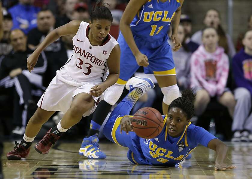Stanford's Amber Orrange and UCLA's Jasmine Dixon dive for the ball during the first half.