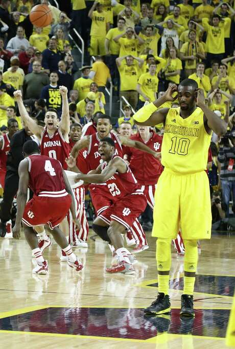 Michigan's Tim Hardaway Jr. turns away as Indiana players celebrate their first outright Big Ten title in 20 years. Photo: Julian H. Gonzalez / Detroit Free Press