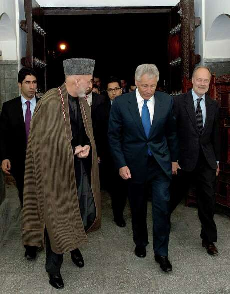 Secretary of Defense Chuck Hagel walks with Afghan President Hamid Karzai during a private meeting in Kabul. Hagel said he was hopeful the U.S. and Afghanistan can overcome the latest crisis. Photo: Erin A. Kirk-Cuomo / Department Of Defense / AFP