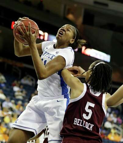 Kentucky center DeNesha Stallworth (11) shoots over Texas A&M forward Kristi Bellock (5)during the first half of their  NCAA college basketball game against the Texas A&M in the finals of the Southeastern Conference tournament, Sunday, March 10, 2013, in Duluth, Ga.  (AP Photo/John Bazemore) Photo: John Bazemore, Associated Press / AP